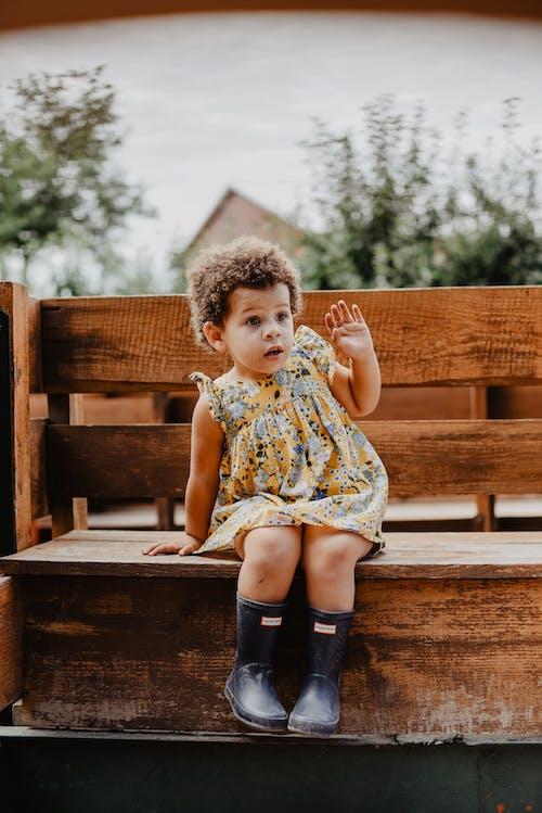 Toddler Sitting On Bench