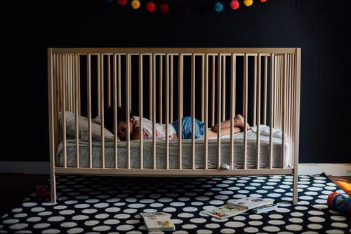 Toddler In A Crib