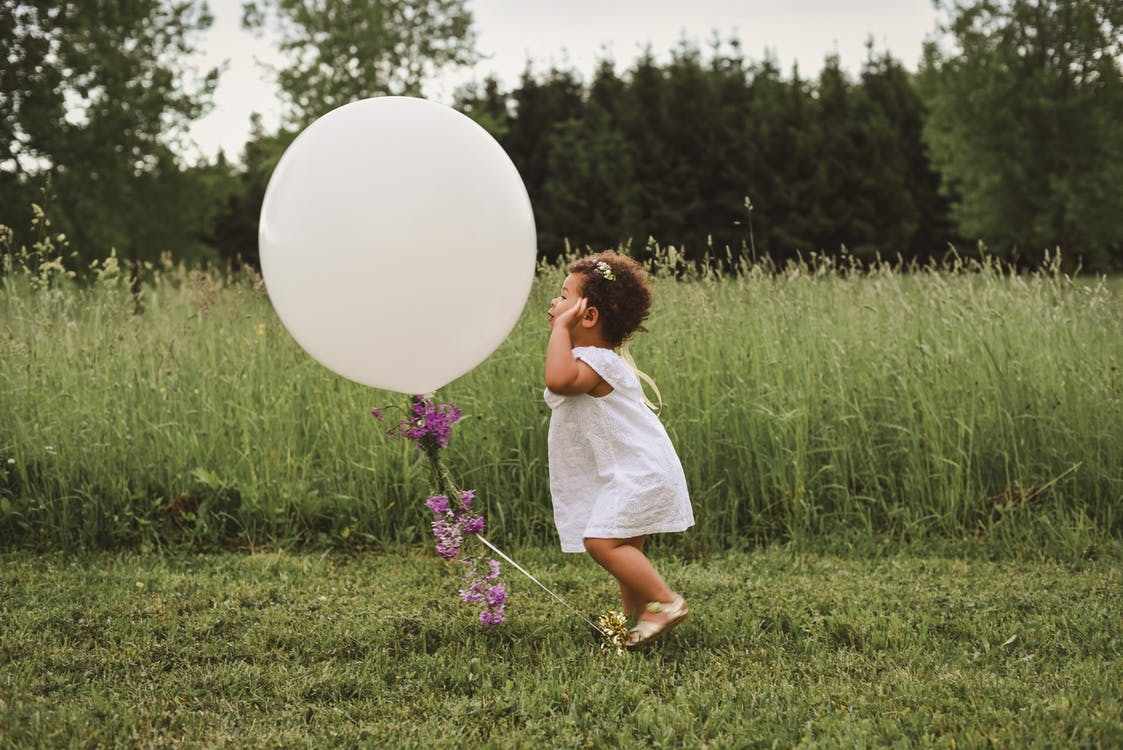 Girl Playing With Balloon