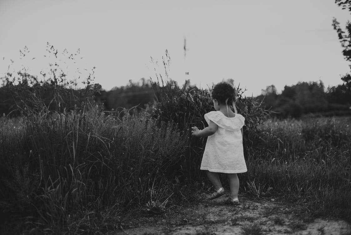 Toddler Standing on Grass