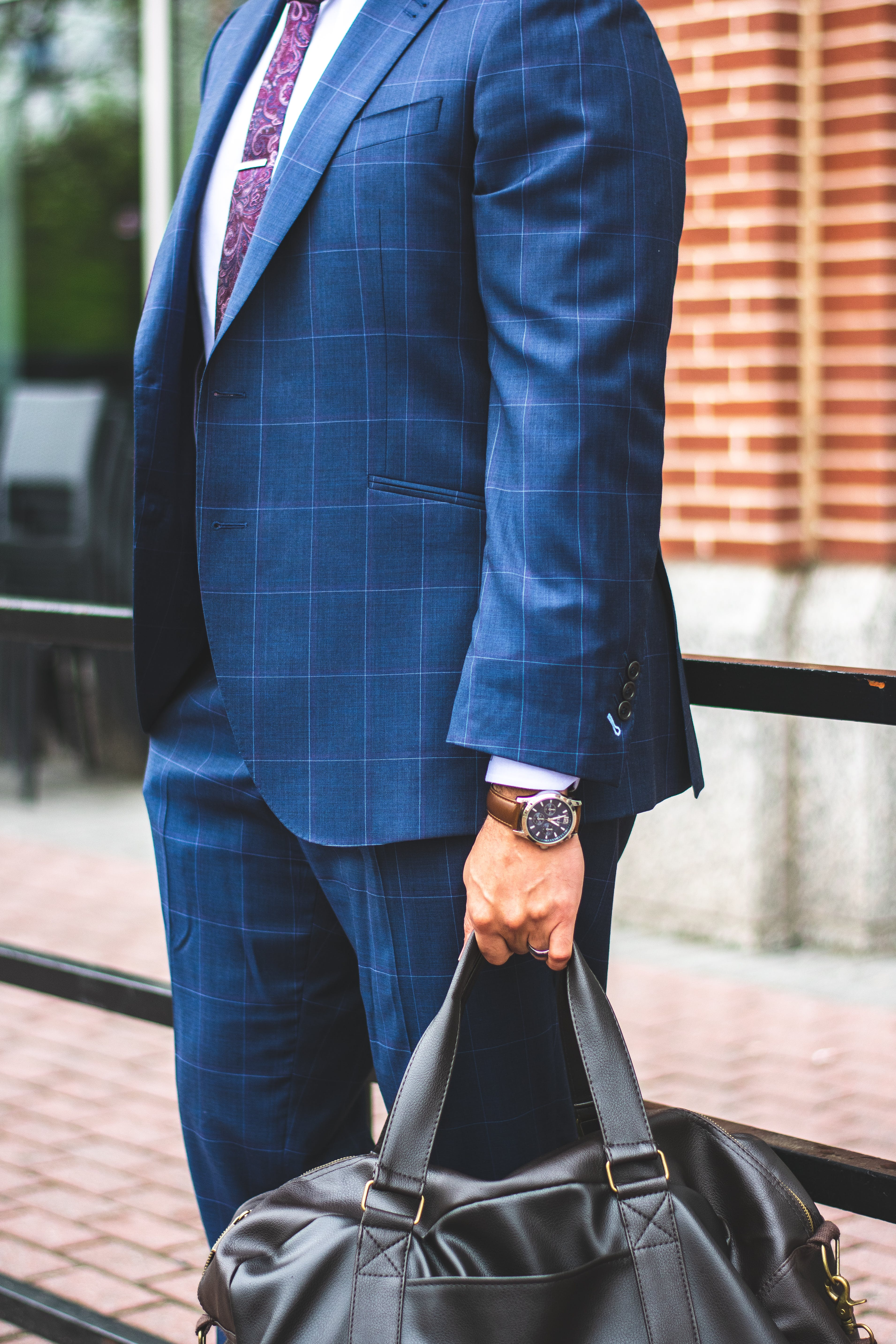 Person Wearing Blue Suit Jacket and Dress Pants Holding Tote Bag