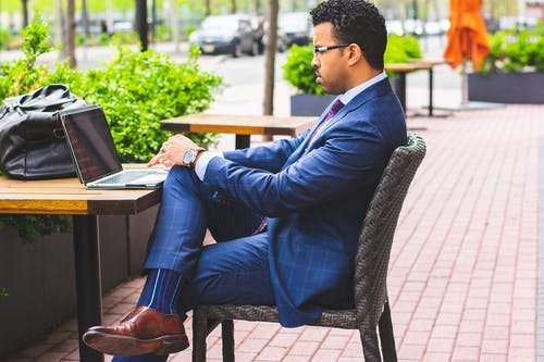 Sitting Man Wearing Formal Suit Using Laptop Computer