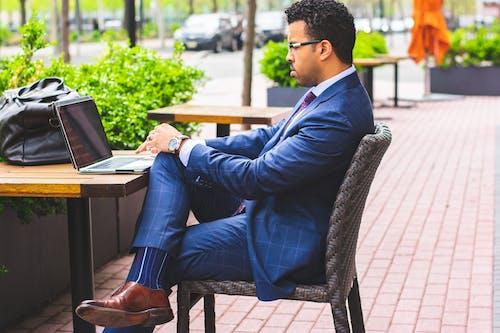 Sitting Man Wearing Formal Suit Using Laptop Computer