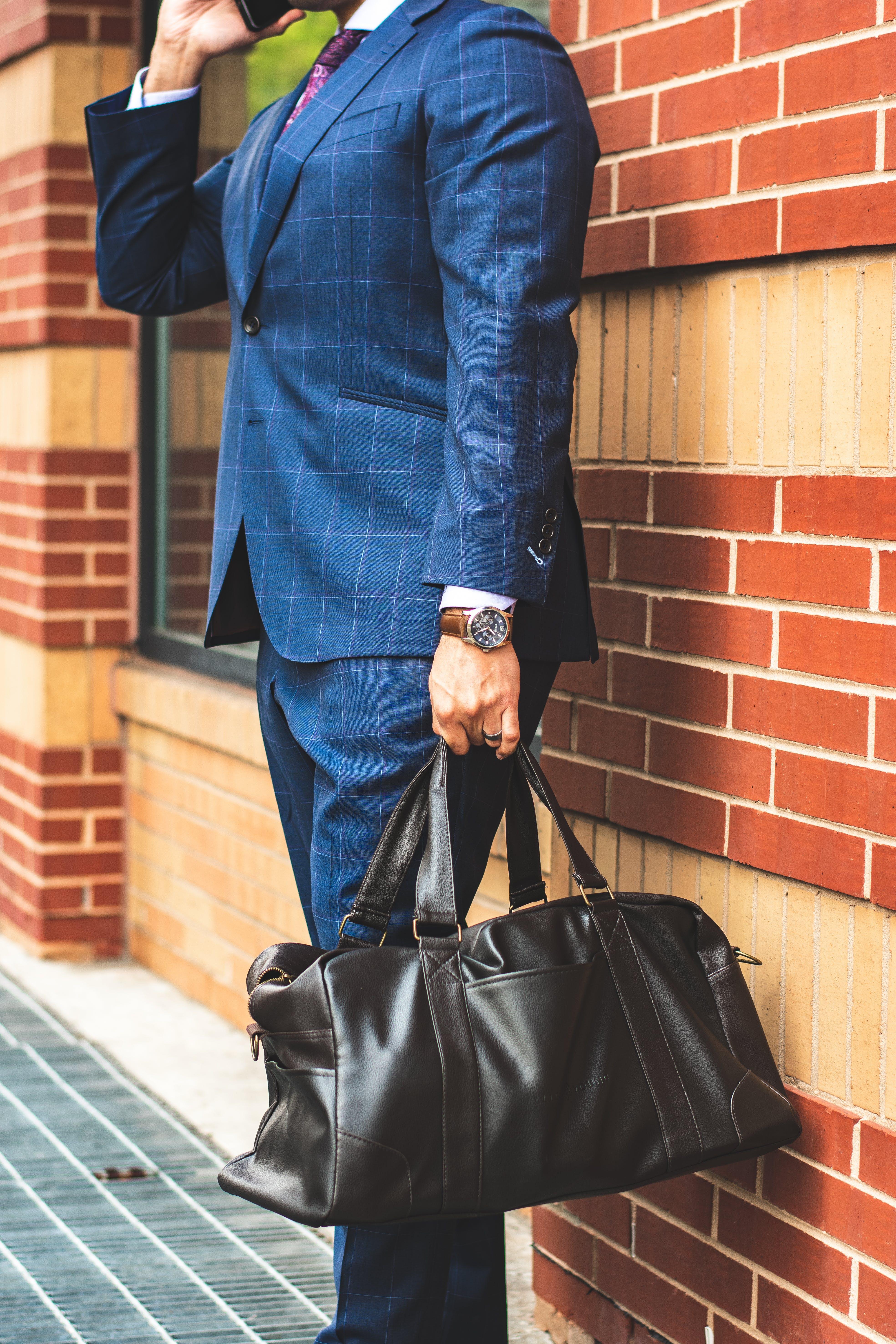 Foto d'estoc gratuïta de a l'aire lliure, bossa, carrer, conjunt de roba