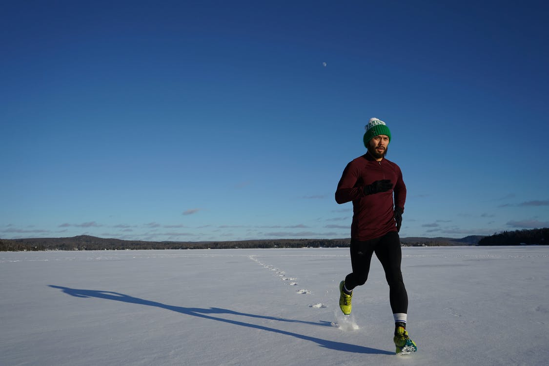 Man Running on Ice Covered Land