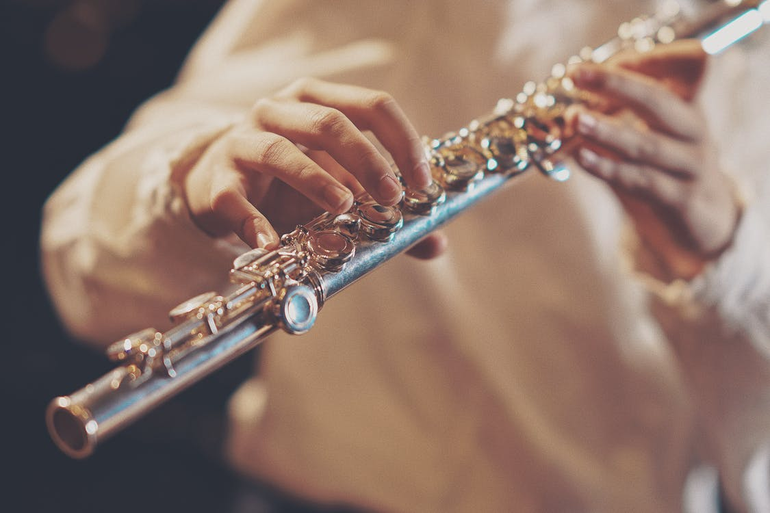 Person Playing Wind Instrument