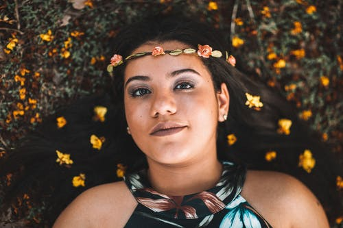 Woman Lying on Ground with flower Crown on her Head