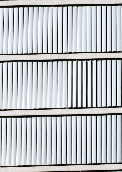 Building with White Window Blinds in Close-up Photo