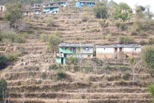 Gratis arkivbilde med fjell, landsby, landsbyboere, topp beliggenhet