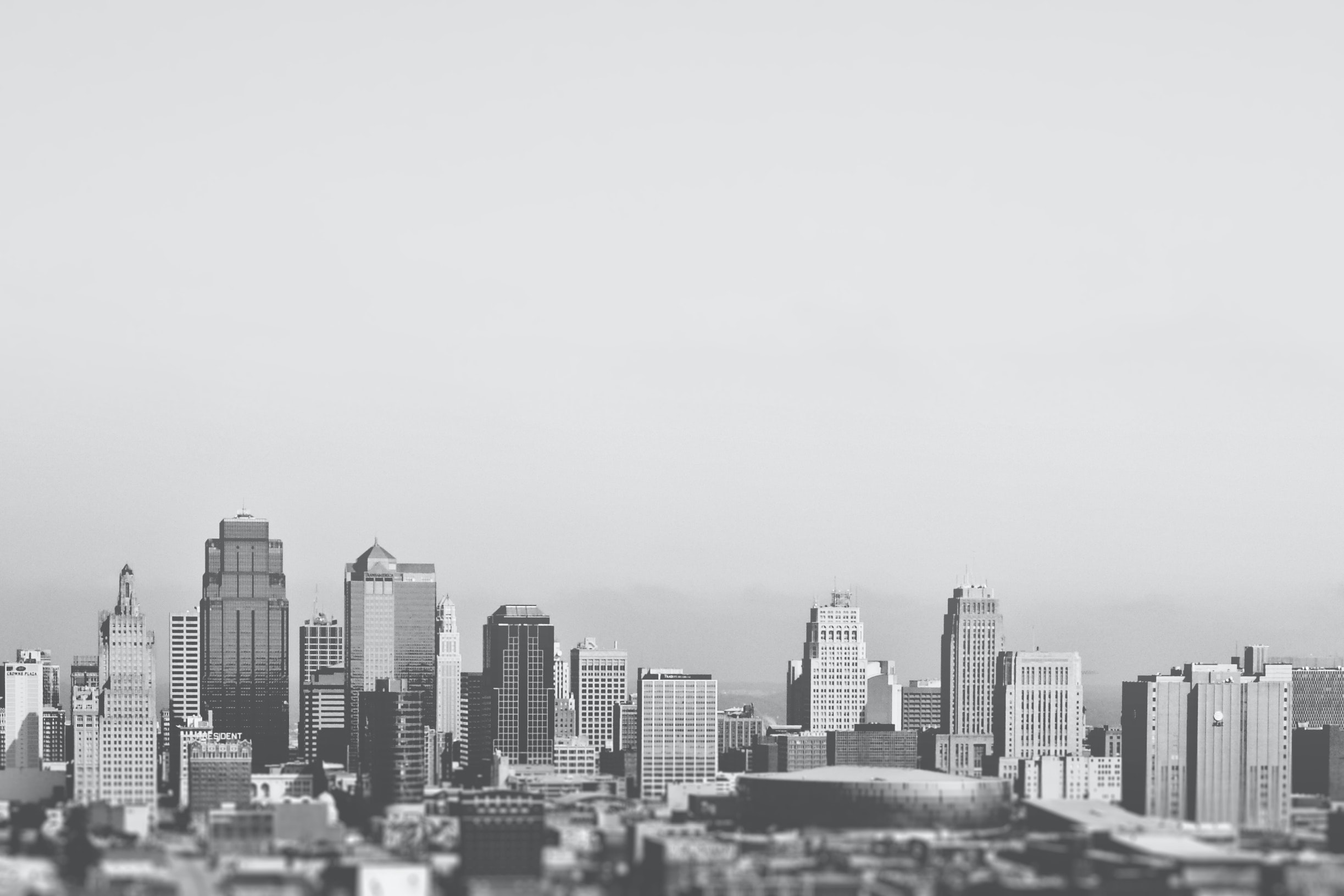 This black and white picture shows the downtown and business district of a typical american city gratisography