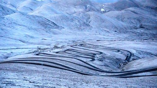 Kostenloses Stock Foto zu ausdauer, berg, schnee, serpentine