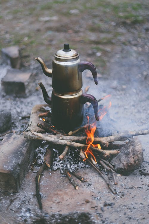 Gray Turkish Kettle on Burning Woods