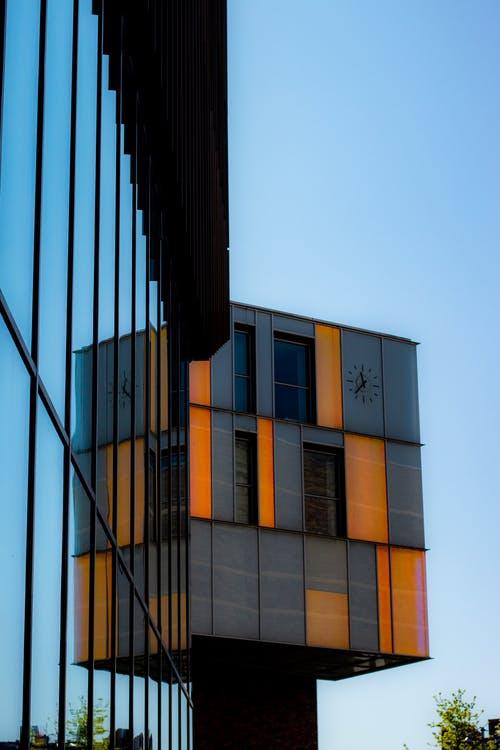Black and Orange Glass Curtain Building