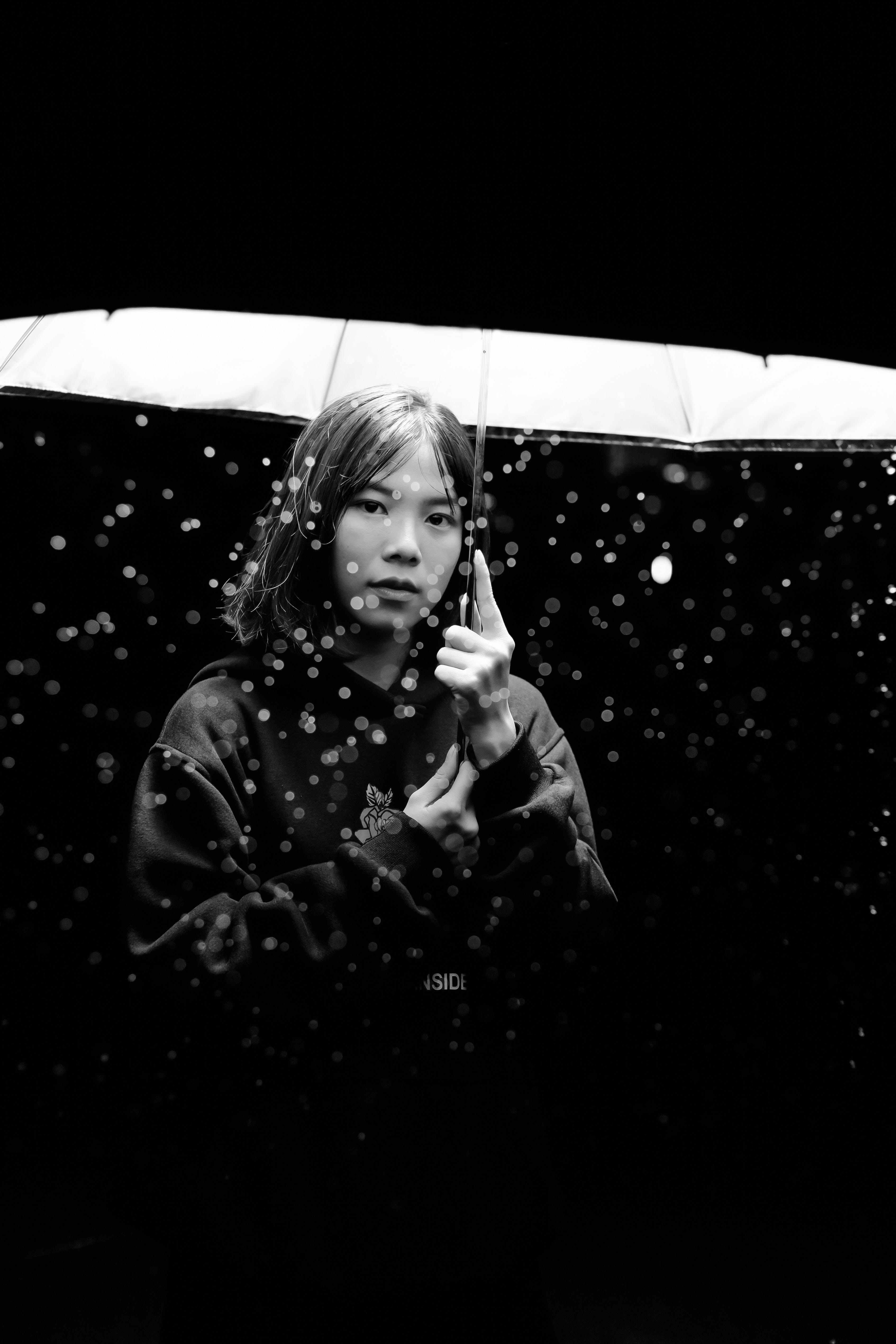Greyscale Photography of Woman Holding Umbrella