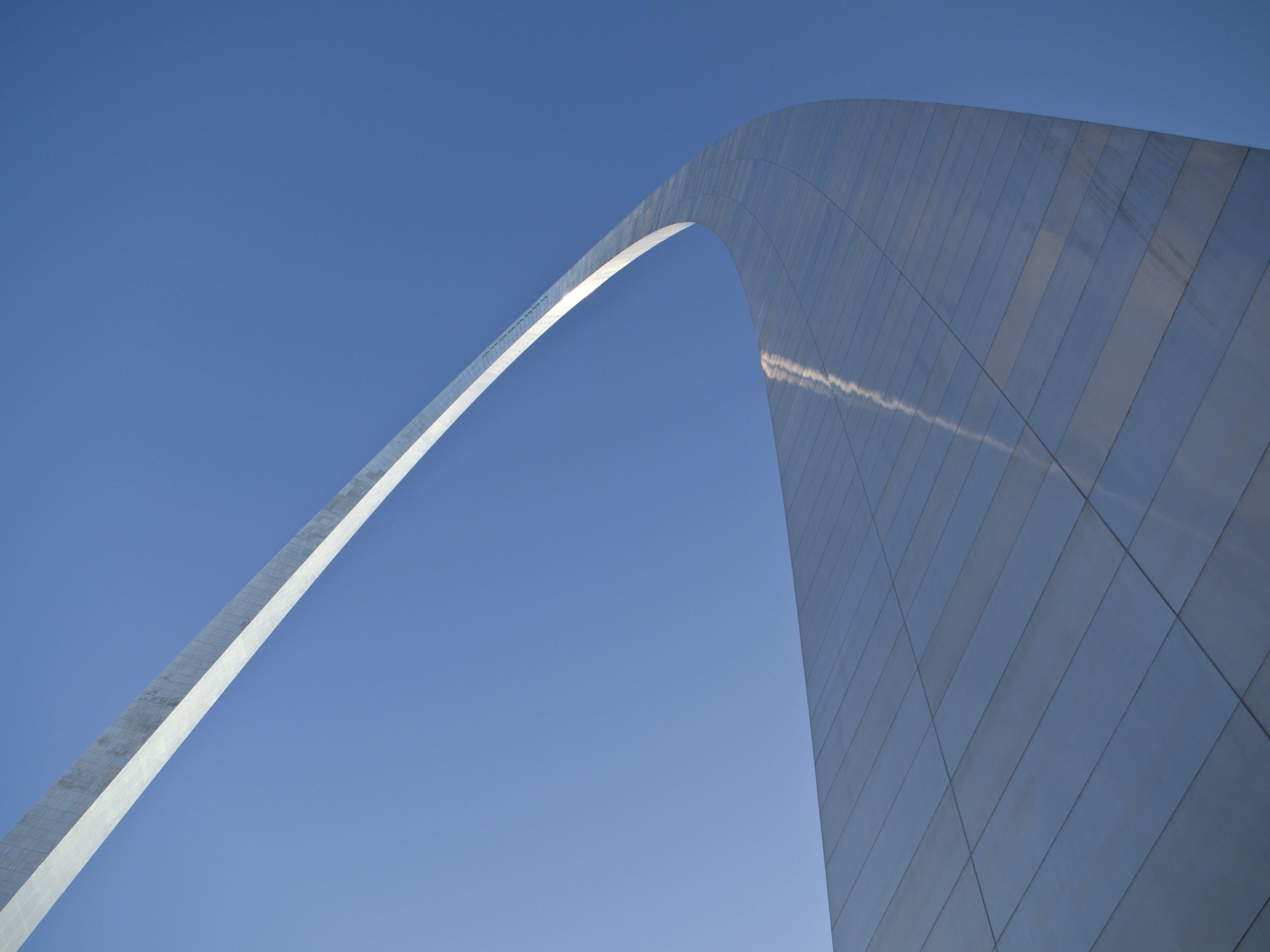Grey Arc Building Under Blue Sky
