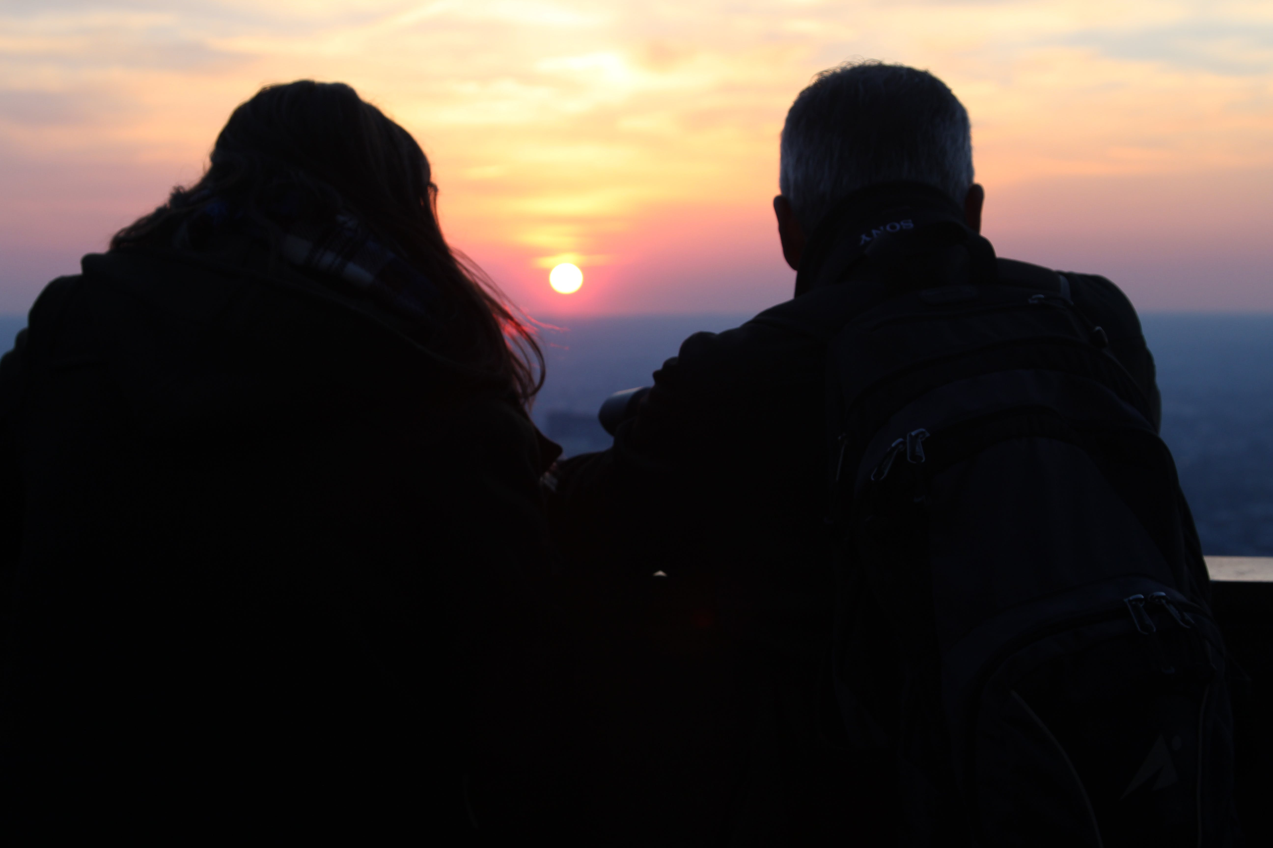 Two Silhouette Person Watching the Sunset