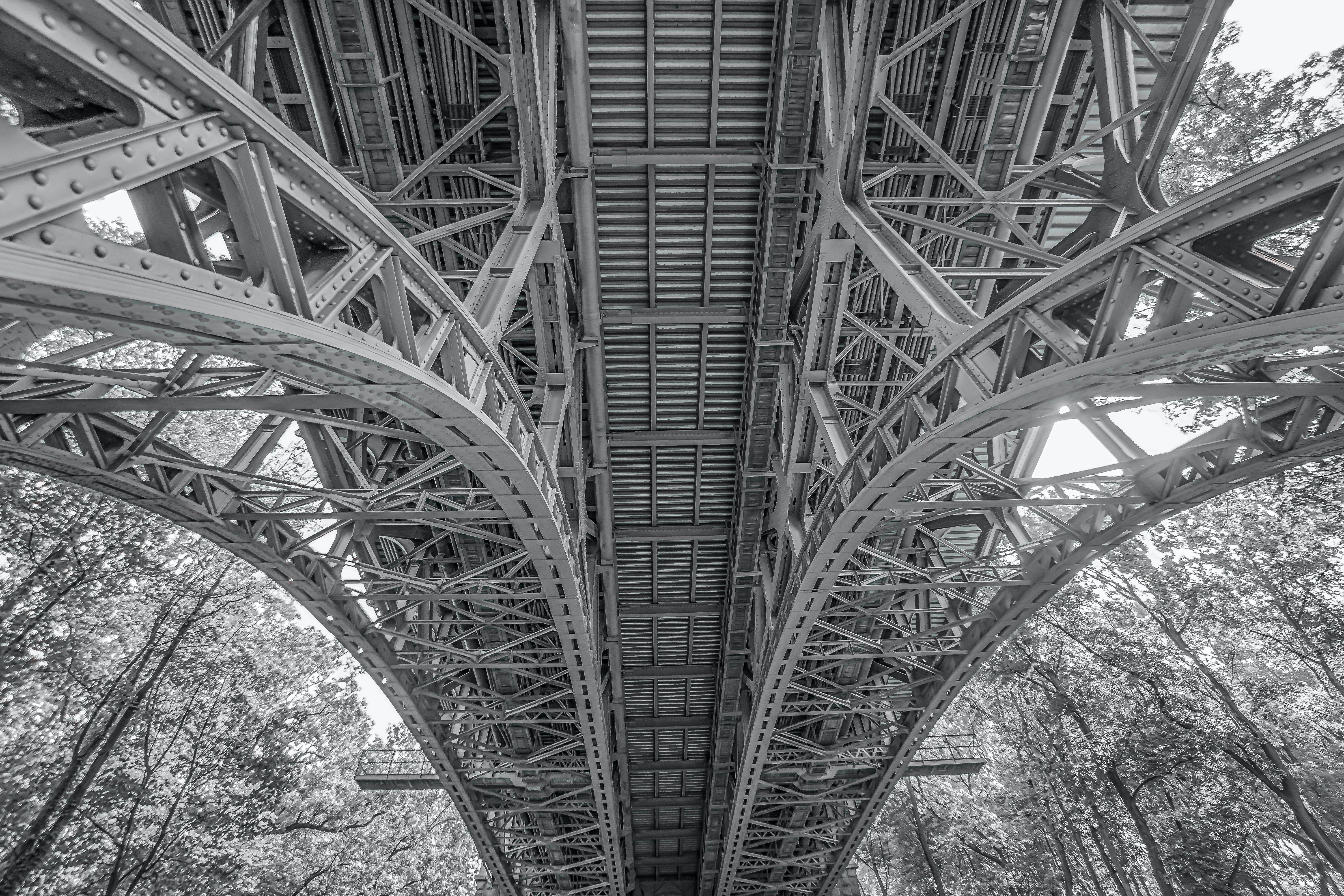 Under the Bridge Greyscale Low Angle Photograph