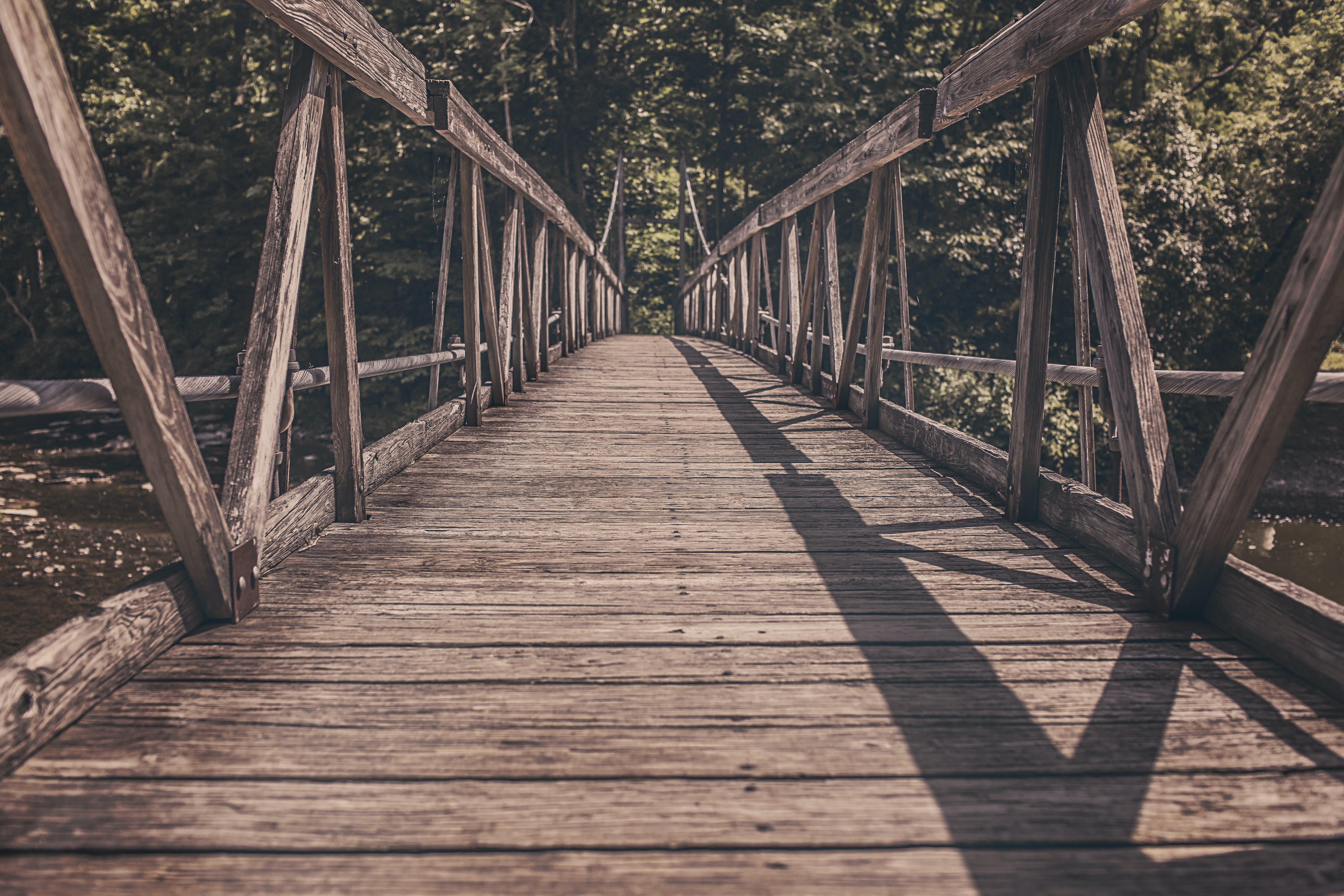 Alley Photography of Brown Wooden Bridge