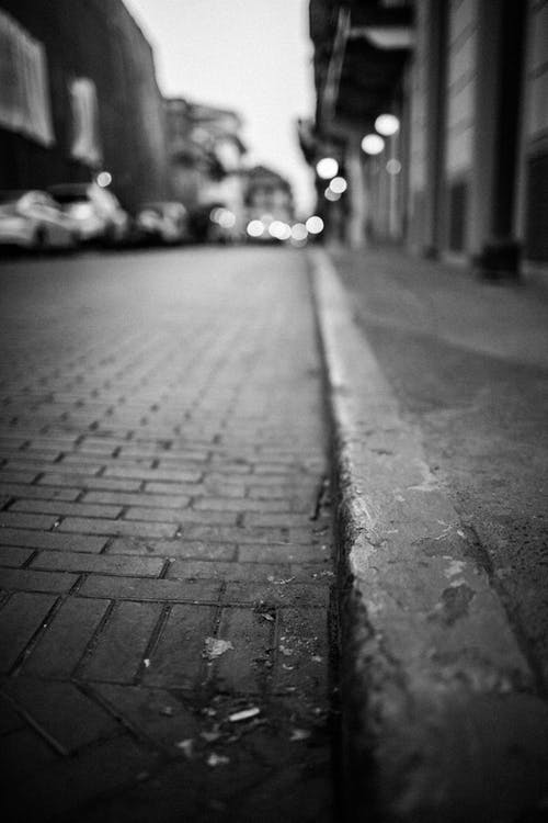 Grayscale Photography Of Sidewalk