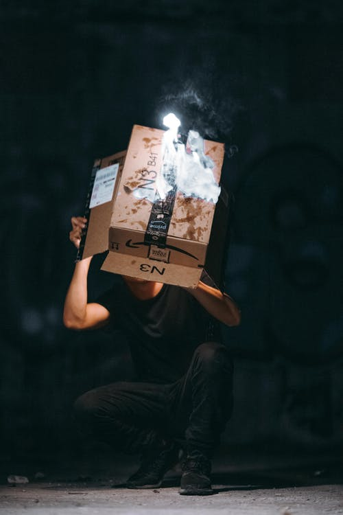Man Raising Cardboard Box