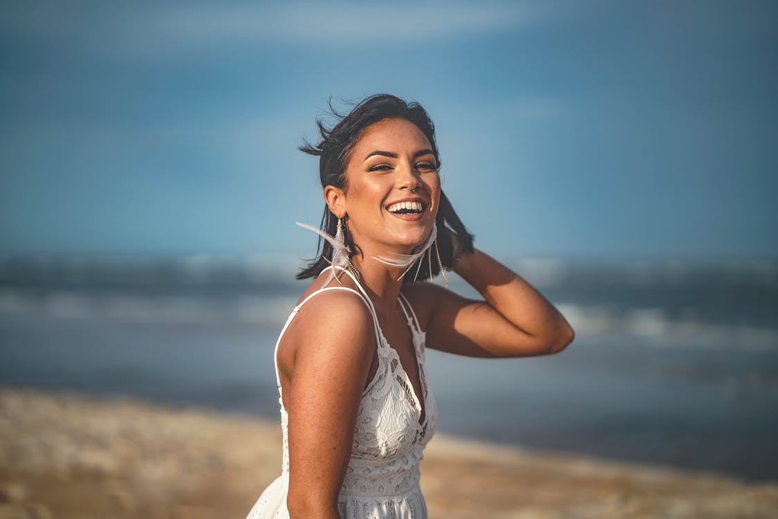 Smiling Woman Holding Her Hair