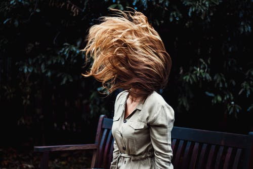 Photo of Woman Doing Hair Flip