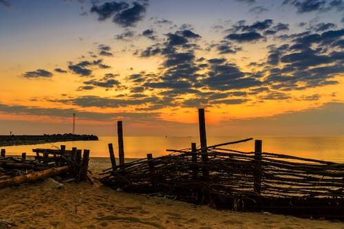 Безкоштовне стокове фото на тему «Захід сонця, море, пляж, Природа»