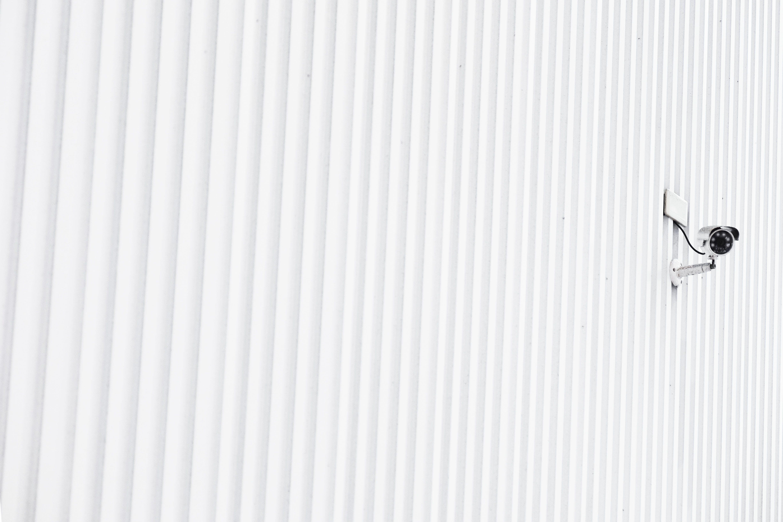 Cctv Camera On White Wall