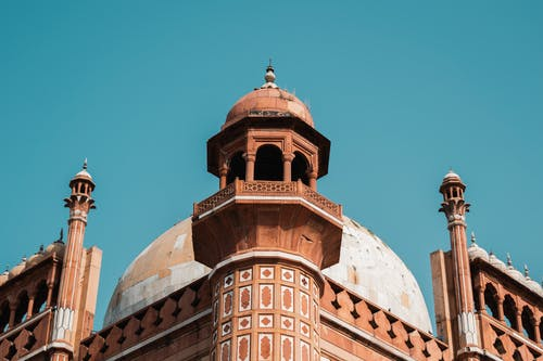 Low Angle Photography of Brown and White Mosque Under Blue Sky