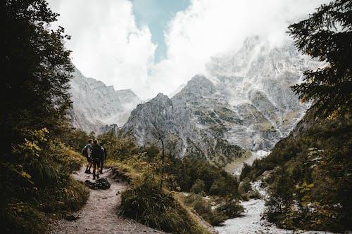 People Hiking Near Mountains