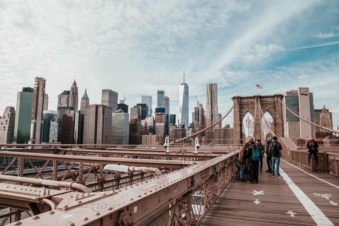 People Standing on Brown Bridge
