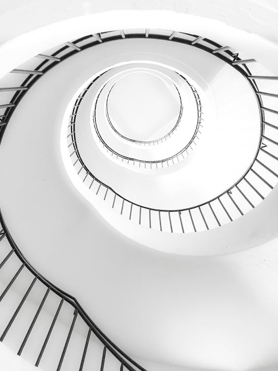 White Spiral Stairs With Black Metal Railings
