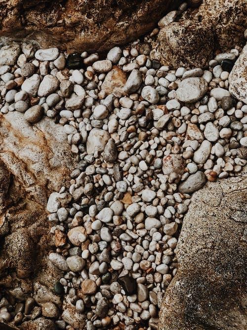 Foto profissional grátis de pedras, pedrinhas, textura