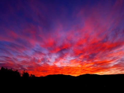 Бесплатное стоковое фото с восход, облака