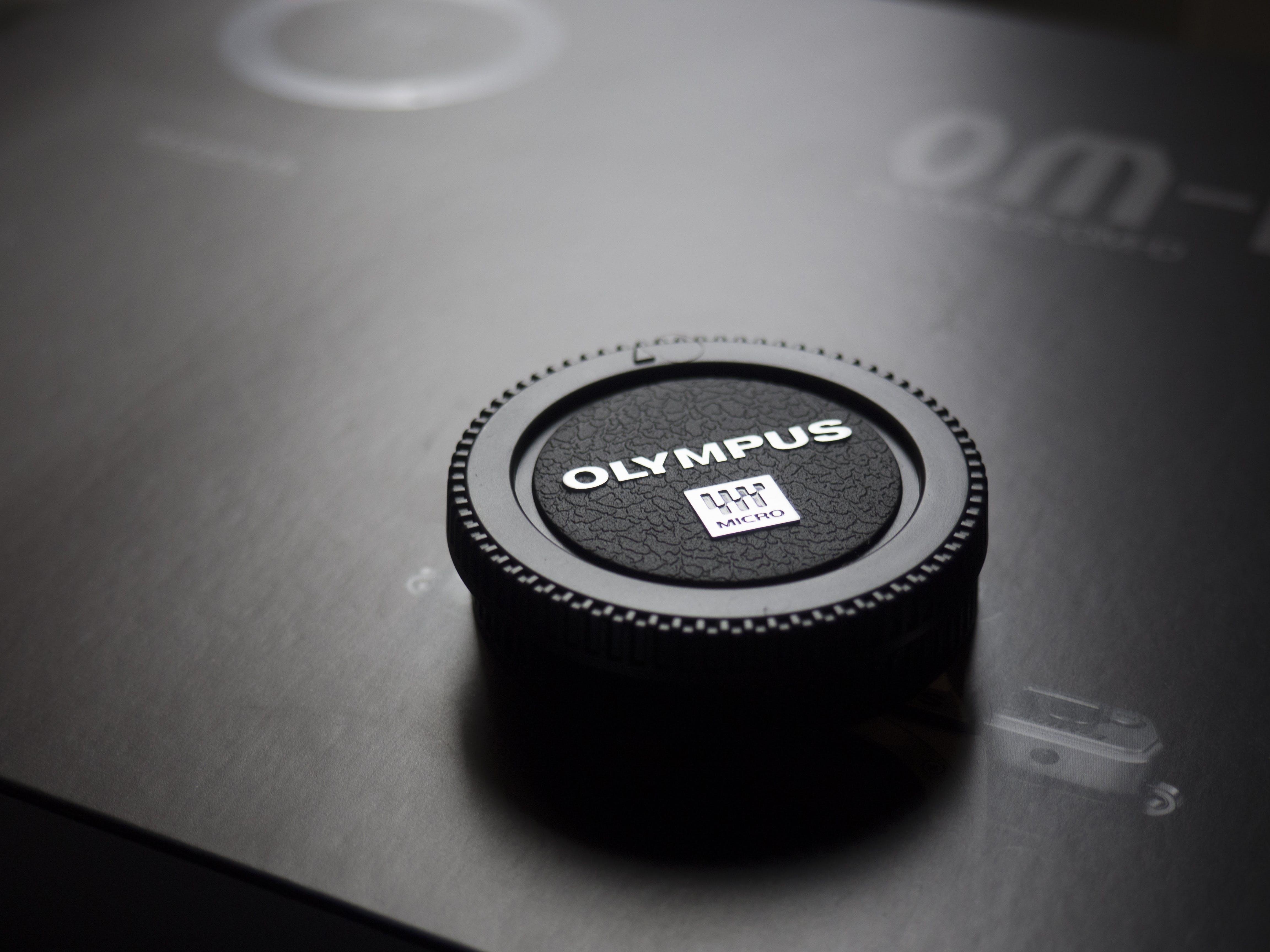Olympus Camera Lens Cap Placed on Box