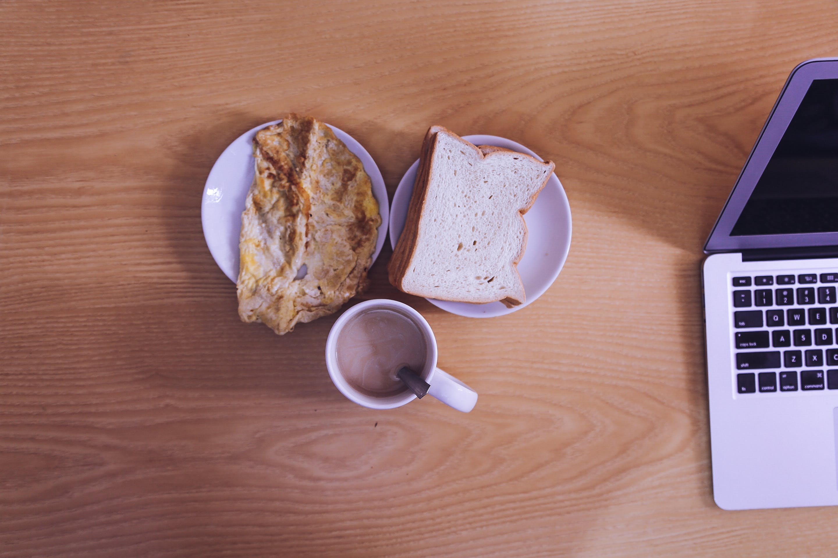 White Ceramic Mug Beside Bread on White Ceramic Saucer