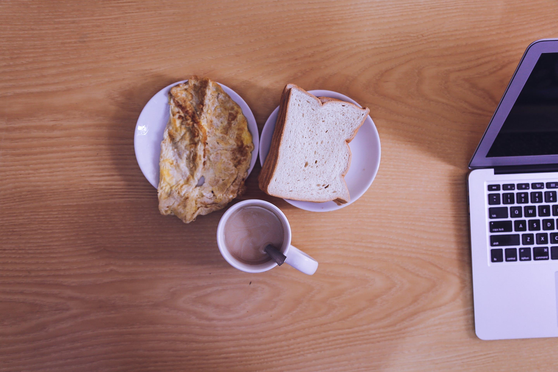 White Ceramic Mug Beside Bread on White Ceramic Saucer