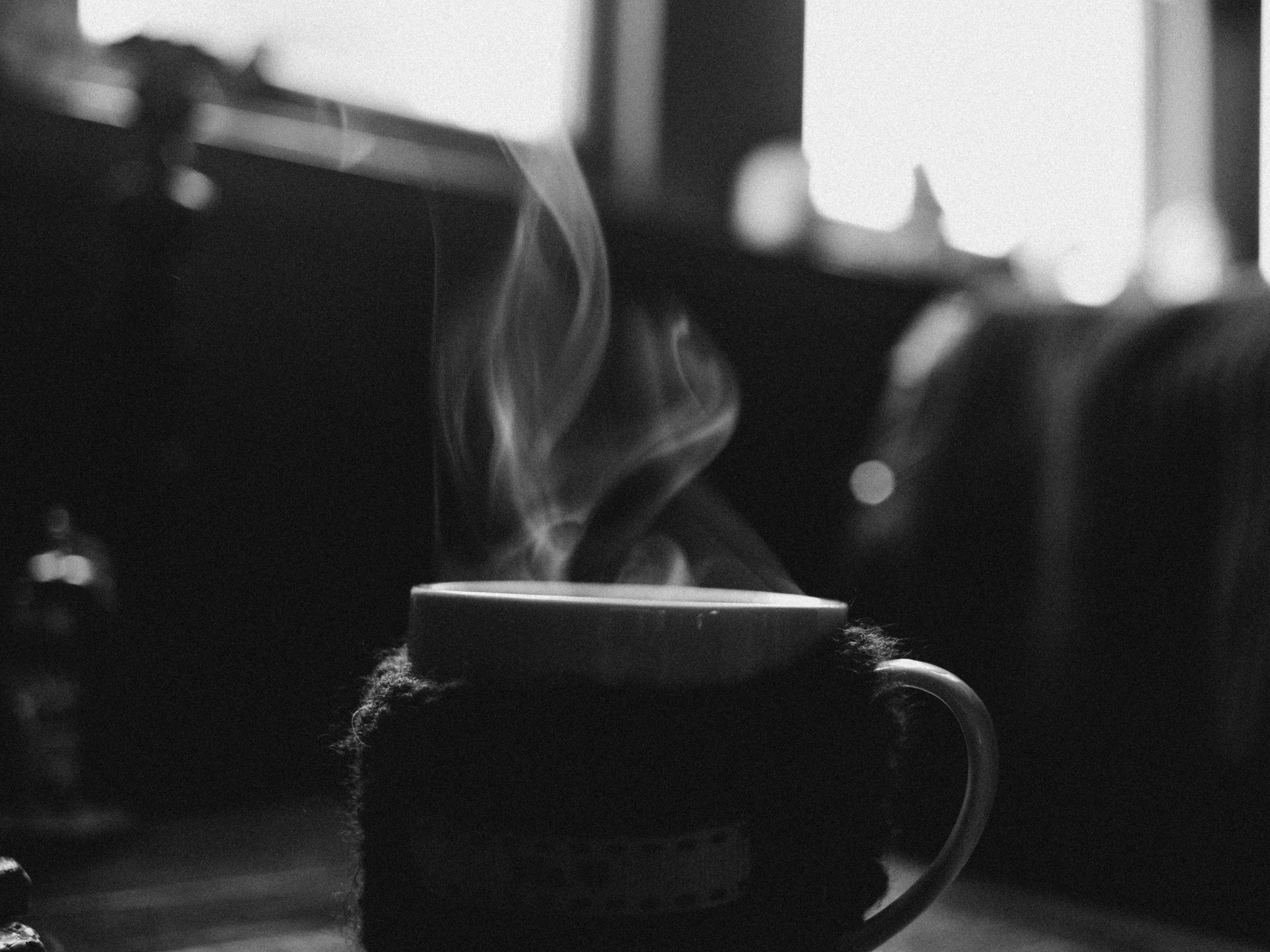 Grayscale Photo of Steaming Mug