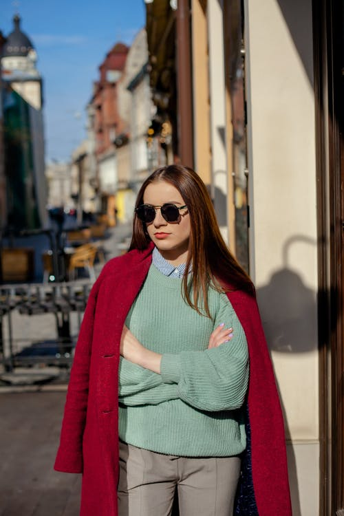 Woman Standing Wearing Green Sweater