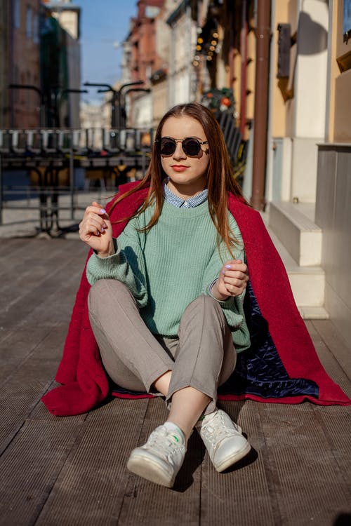Woman Wearing Teal Knit Sweater