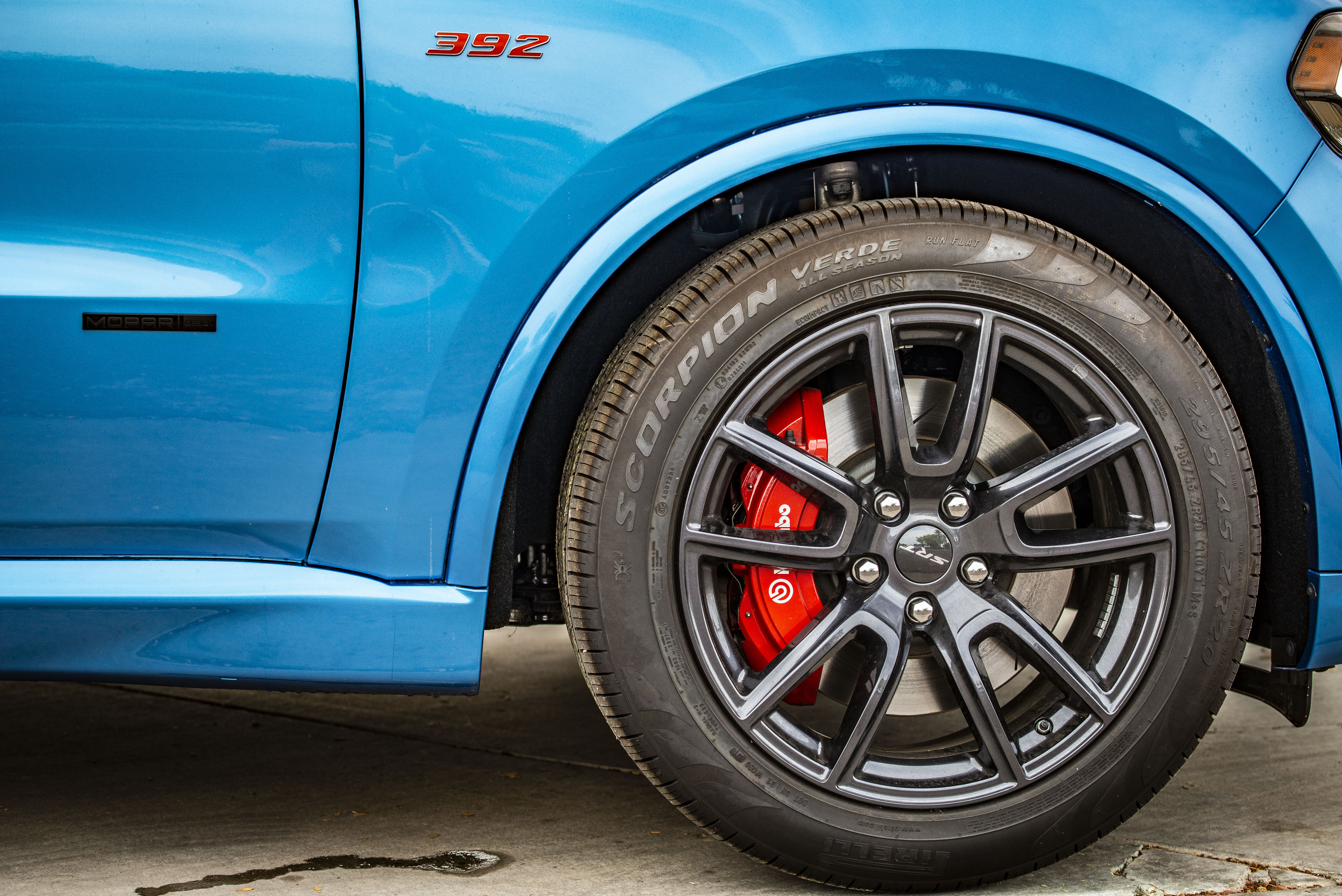 Blue Vehicle Wheel With Black Tire