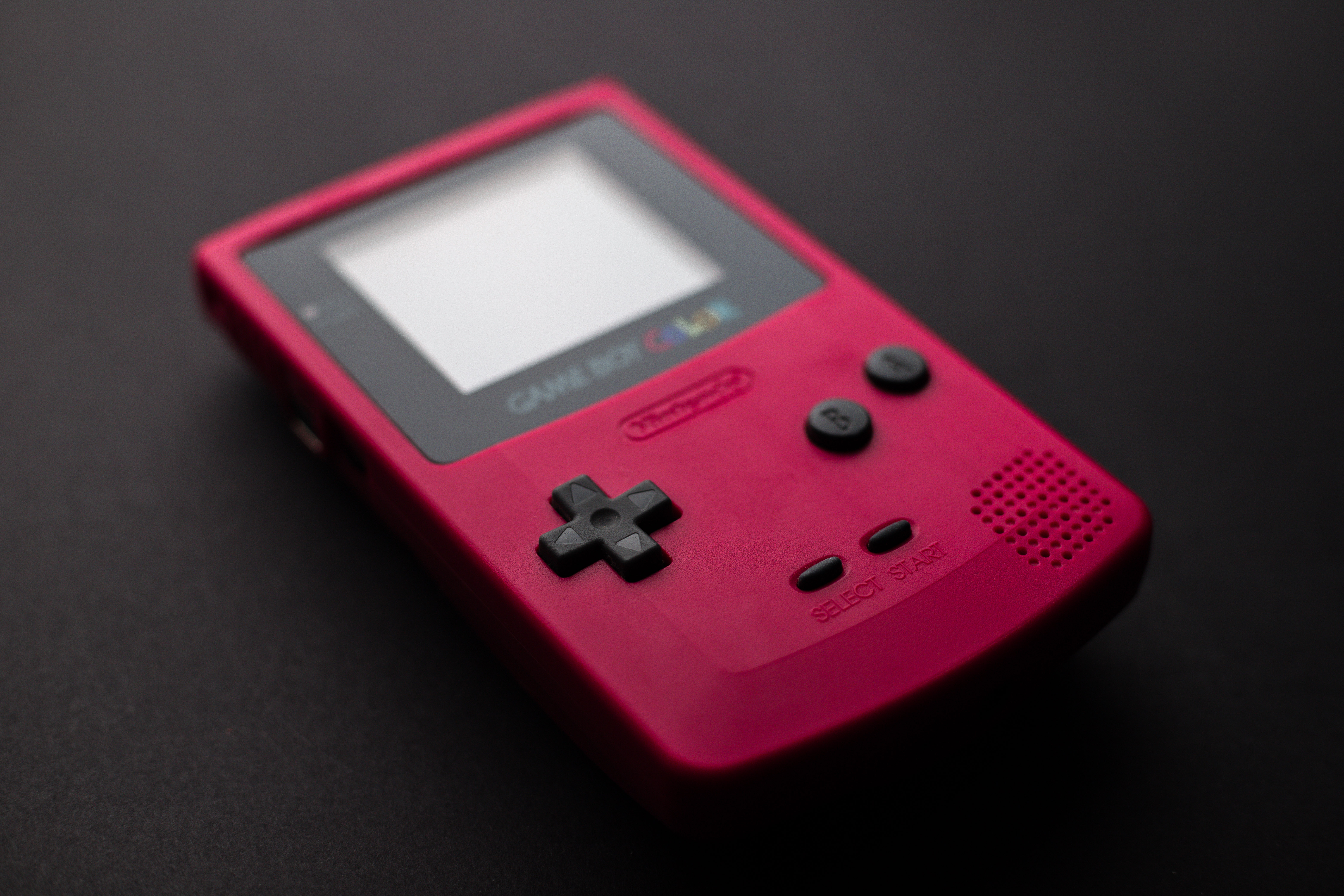 Close-up Photo of Red Game Boy Console