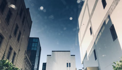 White and Gray Concrete Building Under Clear Sky