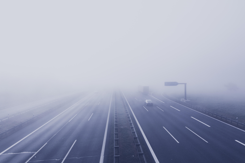 Black Car on Hi-way With Fog