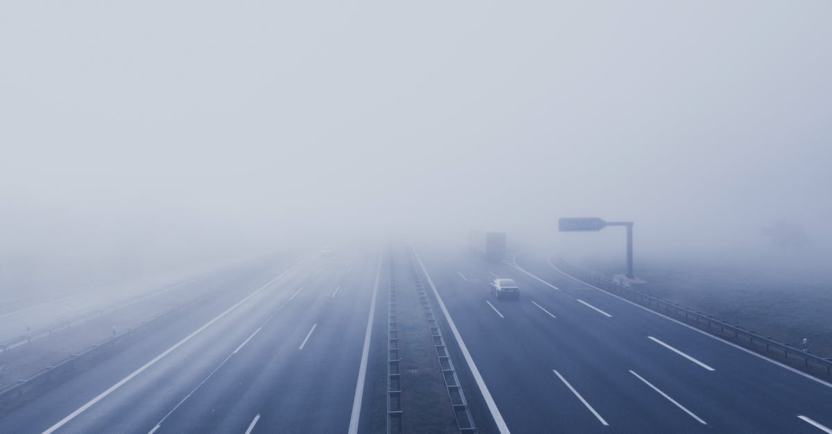 Black Car on Hi-way With Fog