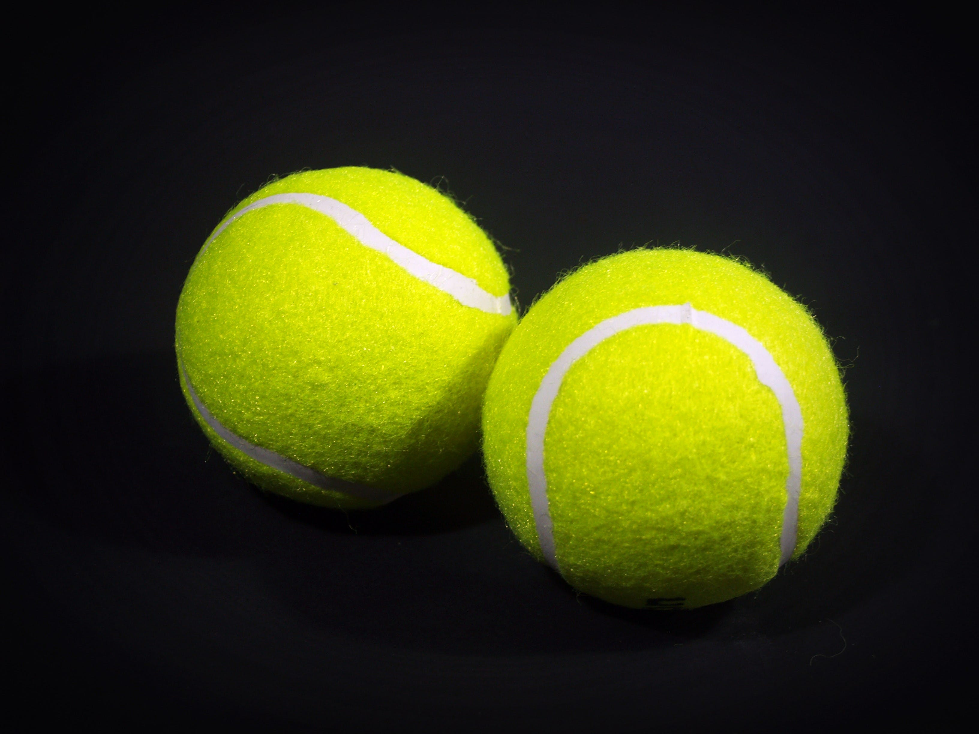 Two Green Lawn Tennis Balls