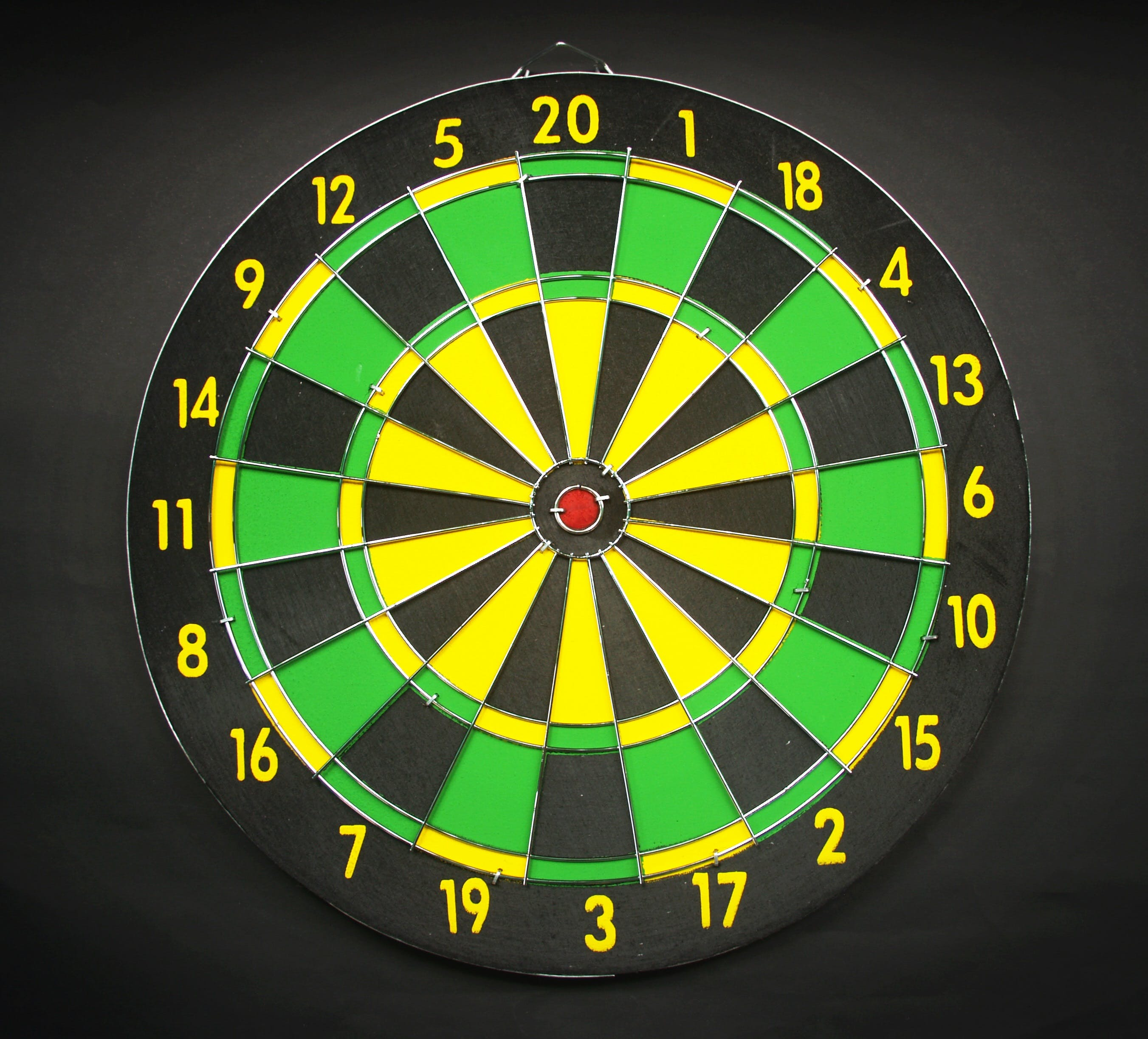 Green Yellow and Black Round Dart Board With Black Background