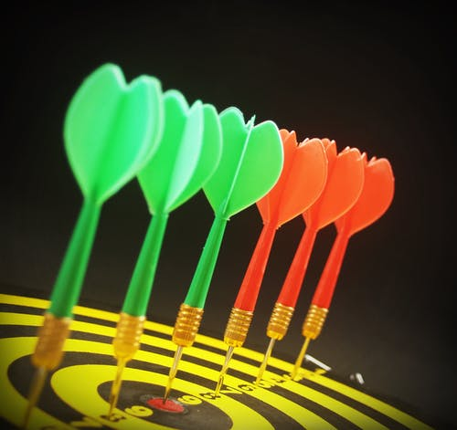 Assorted Color Dart Pins on Dart Board