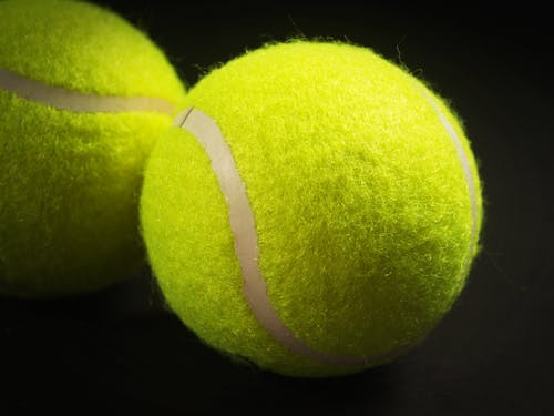 Shallow Focus Photo of Two Tennis Balls