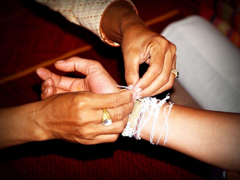 Person Putting White Bracelet